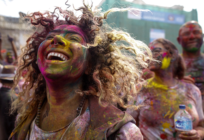 Nepalese people painted with colored powder dance during celebrations of the Holi Festival in Kathmandu, Nepal, March 1
