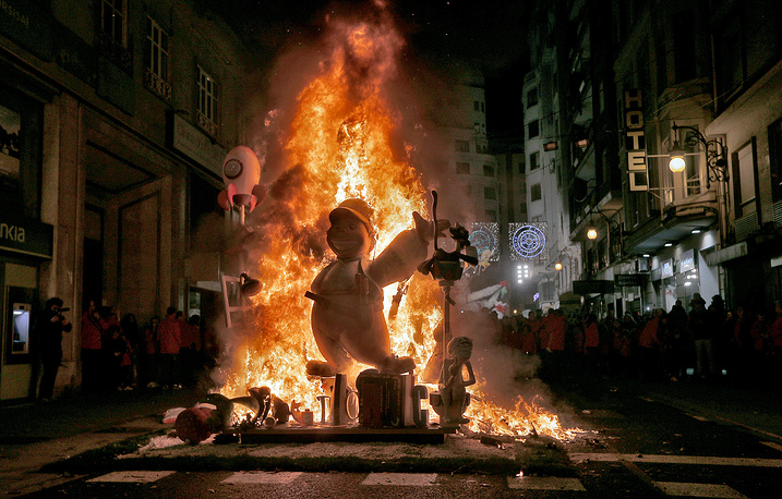 A 'Ninot' or wooden sculpture is burned at Las Fallas in Valencia, Spain