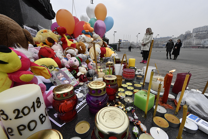Candles and stuffed toys brought to a monument to the Fighters for Soviet Power in the Far East in Vladivostok