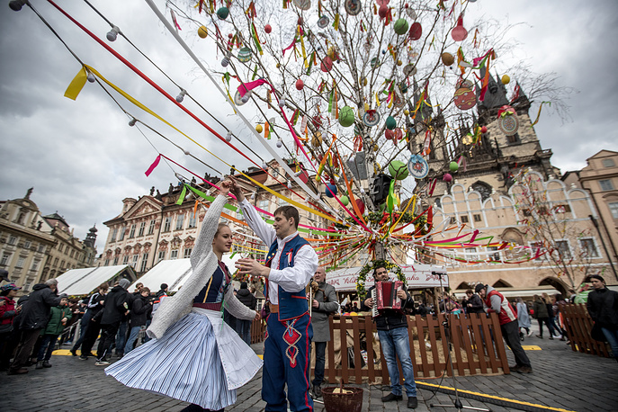 Folkloric dancers perform at the traditional Easter market at the Old Town Square in Prague, Czech Republic