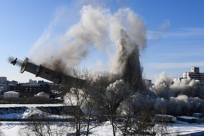 An abandoned TV tower built in the late 1980s, comes crashing down as it is being demolished in Yekaterinburg, Russia, March 24