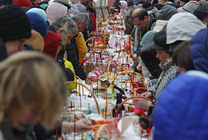 Russian Orthodox Church believers prepare their Easter cakes and eggs for blessing in Donskoi monastery in Moscow