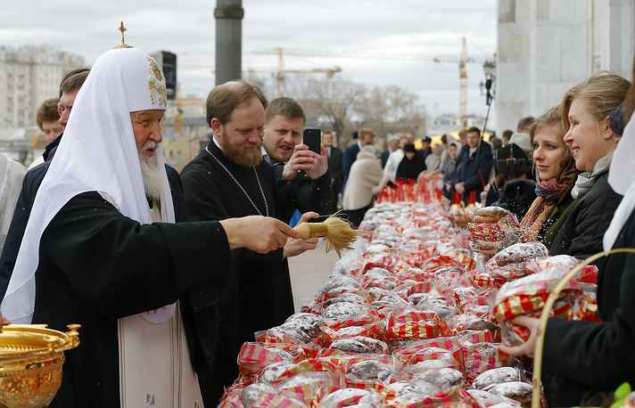 Russian Orthodox Church Patriarch Kirill blesses believers as they collect traditional cakes and painted eggs prepared for an Easter celebration at the Christ the Savior Cathedral in Moscow