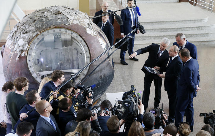 Moscow Mayor Sergei Sobyanin speaks as Russian President Vladimir Putin, State Space Corporation ROSCOSMOS Director General Igor Komarov and Russian Deputy Prime Minister, Dmitry Rogozin listen as they visit the reconstructed historical 'Space' pavilion at the VDNH exhibition center in Moscow, Russia, April 12