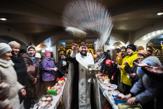 Orthodox priest blesses Easter cakes and painted eggs at the Church of the Exaltation of the Holy Cross in Omsk on the eve of Easter, a Christian feast celebrated by Orthodox Churches according to the Julian Calendar, April 7