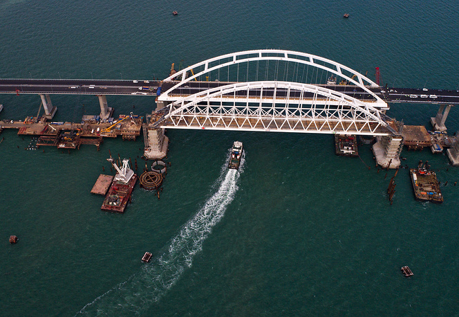 An aerial view of the road arch of a road-rail bridge across the Kerch Strait linking Crimea to mainland Russia, April 25