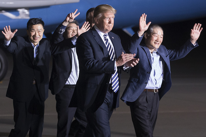 US President Donald J. Trump walks with three US detainees that were released by North Korea after greeting them upon their arrival at Joint Base Andrews, Maryland, May 10