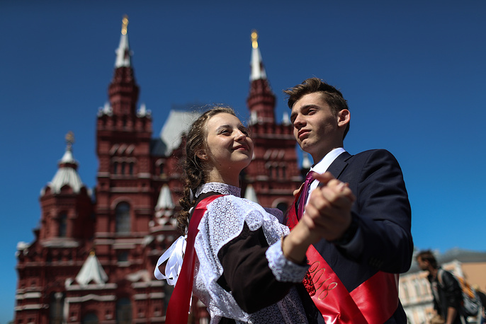 Highschool graduates celebrate the last day of their classes on Red Square in Moscow, May 25