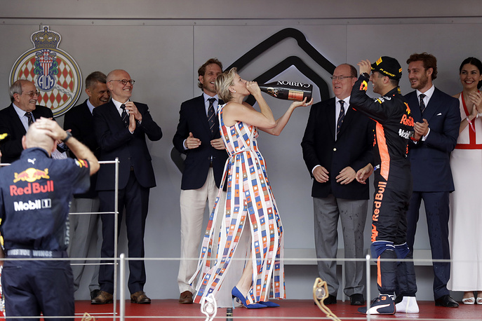 Princess Charlene of Monaco drinking champagne on the podium after Red Bull driver Daniel Ricciardo of Australia winning the Formula One race, at the Monaco racetrack, in Monaco, May 27