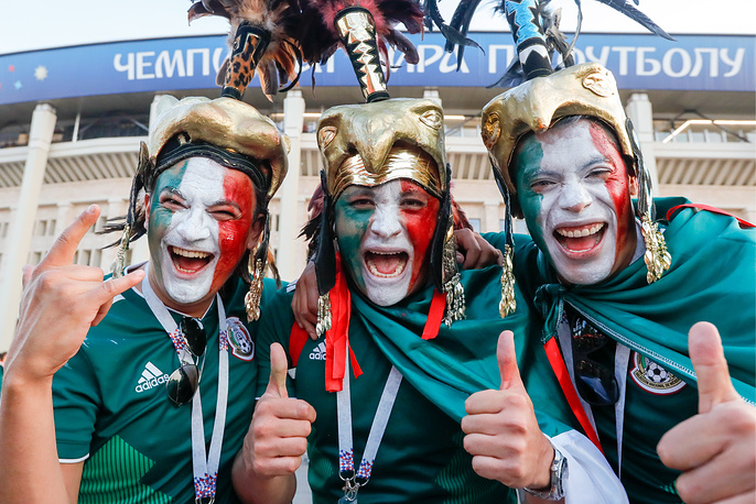 Mexican football fans with painted faces outside Luzhniki Stadium in Moscow