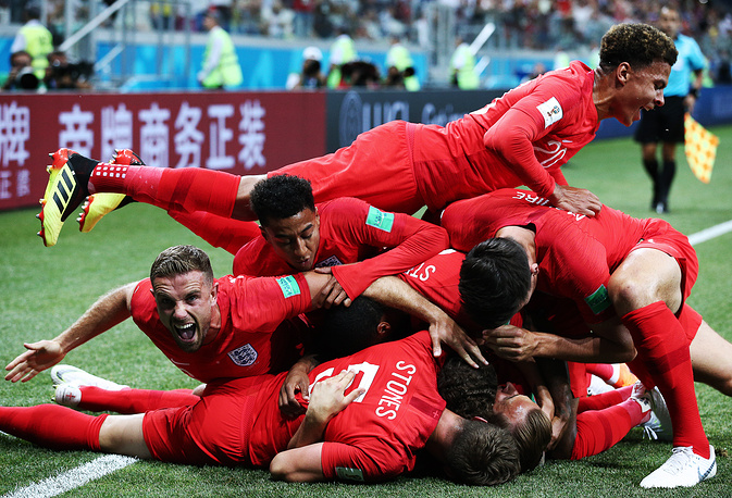 England's players celebrate scoring in the group G match against Tunisia at Volgograd Arena