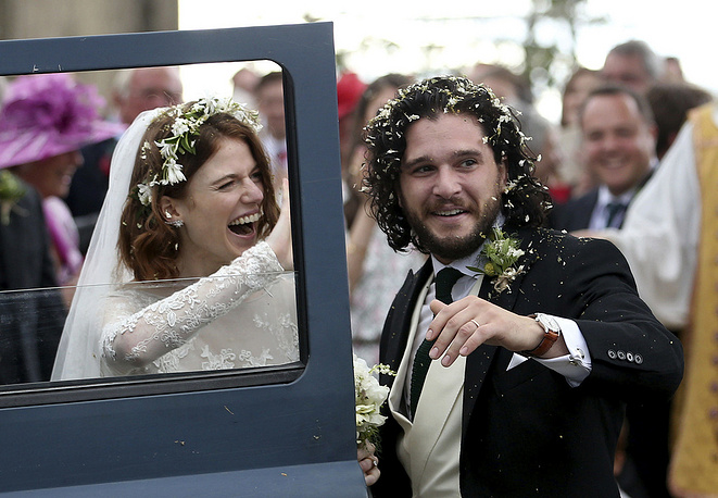 """Actors Kit Harington and Rose Leslie react as they leave after their wedding ceremony, at Rayne Church, Kirkton of Rayne in Aberdeenshire, June 23. Former """"Game of Thrones"""" co-stars married near the bride's family castle in Scotland"""