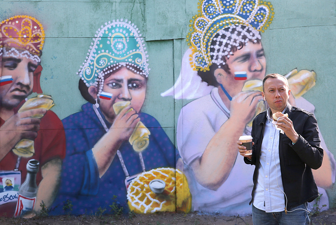 A mural depicting football fans who wore kokoshniks [traditional Russian headdress] and had a snack during the 2018 FIFA World Cup Round of 16 match between Spain and Russia