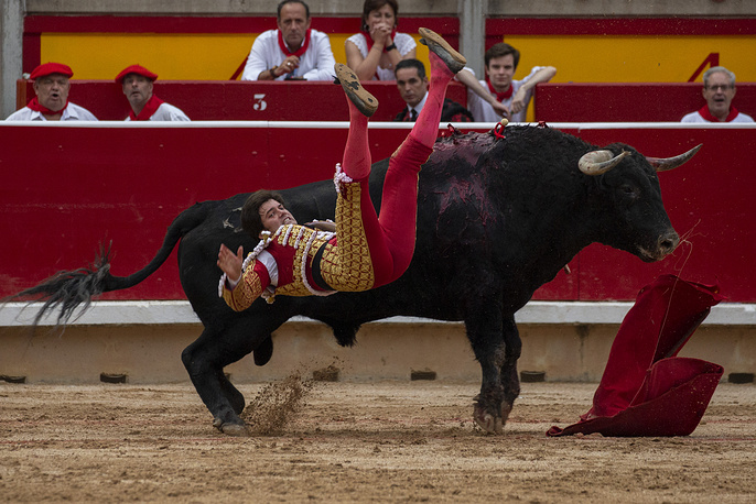 A Spanish matador is hurled into the air as he tried to kill one of Puerto de San Lorenzo's fighting bulls during a bullfight on the second day of the San Fermin Running of the Bulls festival in Pamplona, July 7
