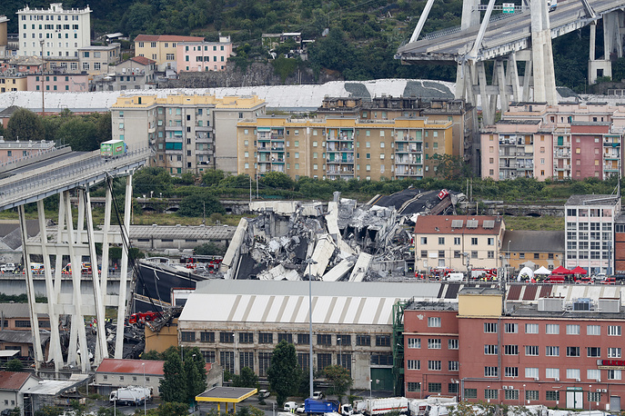 Truck stands still on the Morandi highway bridge after a section of it collapsed in Genoa, on August 14. A large stretch of the bridge came crashing down on an industrial zone in the Italian city of Genova during a sudden and violent storm, crushing vehicles and buildings below