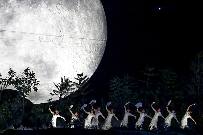 Indonesian dancers perform during the opening ceremony of the Asian Games 2018 at the Gelora Bung Karno Main Stadium in Jakarta, August 18
