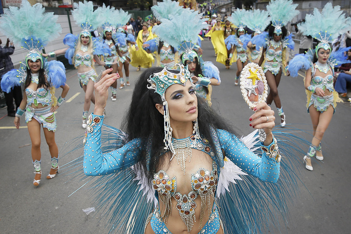 Costumed revellers perform in the parade during the Notting Hill Carnival in London