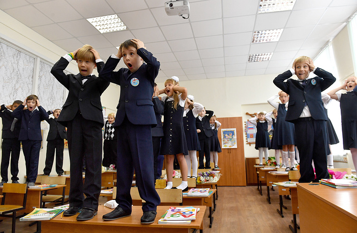 School students attend a class in a secondary school, Moscow region, September 1