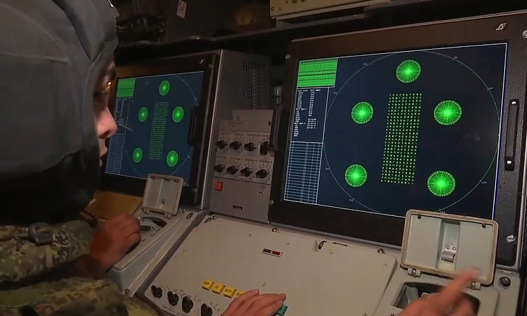 A soldier looks at a radar screen of an S-400 missile system