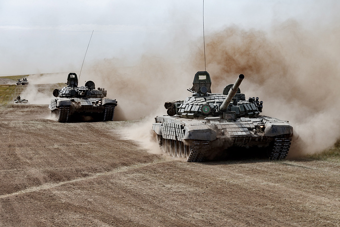 Russian T-72B tanks taking part in the main stage of the Vostok 2018 military exercise