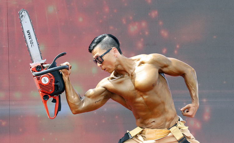 A firefighter from the southwestern city of Jeongeup flexes his muscles while holding an electric saw in a bodybuilding contest of the World Firefighters Games Chungju 2018 in the city of Chungju, South Korea, September 11. The games are regarded as the Olympics of firefighters, with some 6,000 people in the profession from more than 50 countries participating
