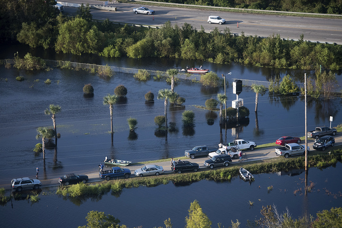 People use a road as a boat ramp after Hurricane Florence struck the Carolinas. Many rivers in the Carolinas are approaching record flood stages and their levels will continue to rise through the week
