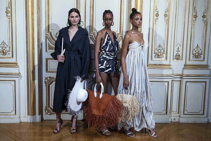 Models present creations by French designer Jacquemus