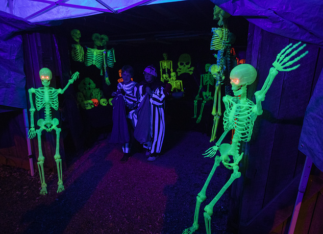 Costumed children trick-or-treat and get scared on Halloween in the historic town of Clifton, USA
