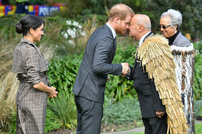 Prince Harry, Duke of Sussex and Meghan, Duchess of Sussex greet Maori elders while attending a traditional welcome ceremony on the lawns of Government House in Wellington, New Zealand, October 28