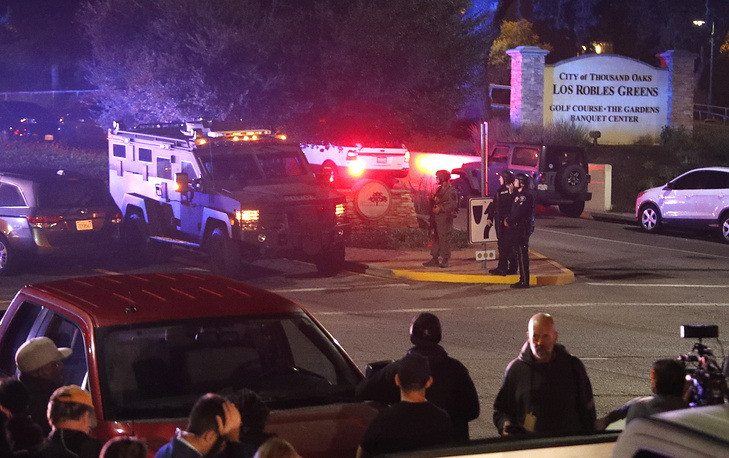 Law enforcement officers secure the road in Thousand Oaks