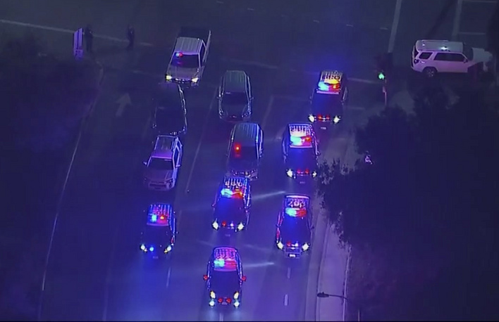 Police vehicles block an intersection in the vicinity of a shooting in Thousand Oaks