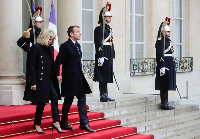 France's President Emmanuel Macron with his wife Brigitte at the Elysee Palace ahead of a ceremony marking 100 years since the end of the First World War