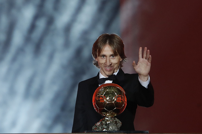 Real Madrid's Luka Modric celebrates with the Ballon d'Or award during the Golden Ball award ceremony at the Grand Palais in Paris
