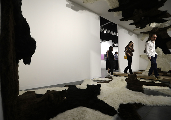 An installation of fake fur rugs by artist Paola Pivi