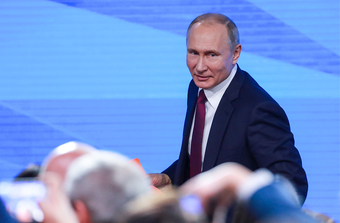 Russia's President Vladimir Putin is seen after his annual end-of-year news conference at Moscow's World Trade Centre