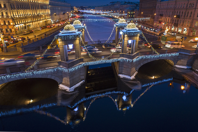 An aerial view of Lomonosov Bridge through the Fontanka River with light decoration for the incoming New Year and Orthodox Christmas celebrations in St.Petersburg, December 17