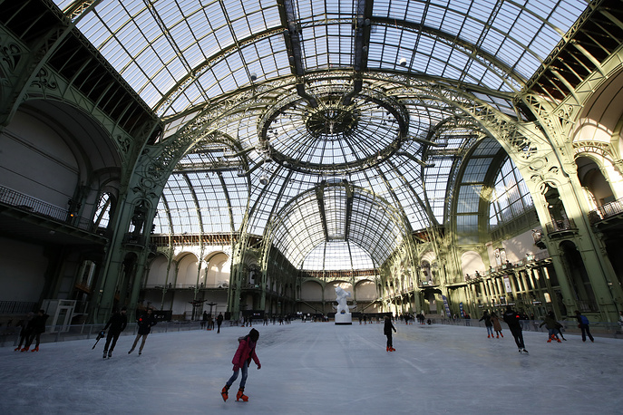 People ice skate at the Grand Palais in Paris, December 17. The Grand Palais skating rink opens to the public during Christmas holidays and is the largest temporary ice rink created in France