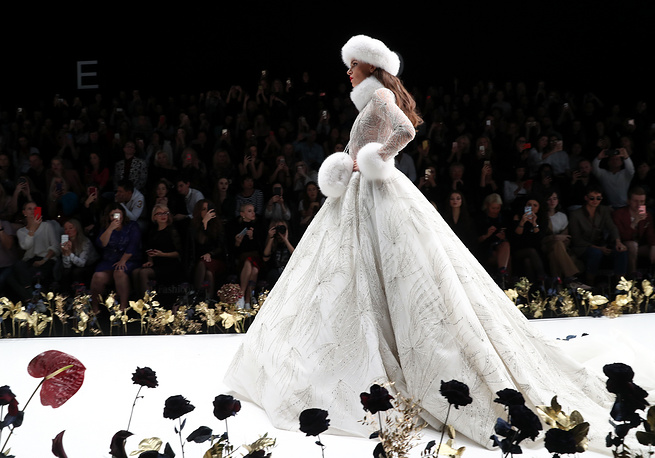 A model showcases a wedding goan during a catwalk show for the Speranza Couture spring/summer 2019 collection as part of the Mercedes-Benz Fashion Week Russia at the Manege Central Exhibition Hall in Moscow