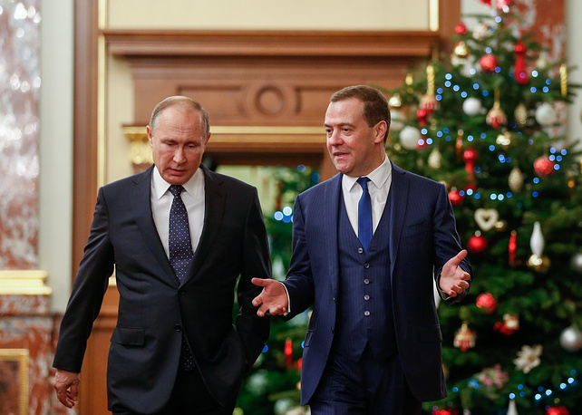 Russia's President Vladimir Putin and Russia's Prime Minister Dmitry Medvedev are seen during Putin's end-of-year meeting with members of the Russian Government, December 26