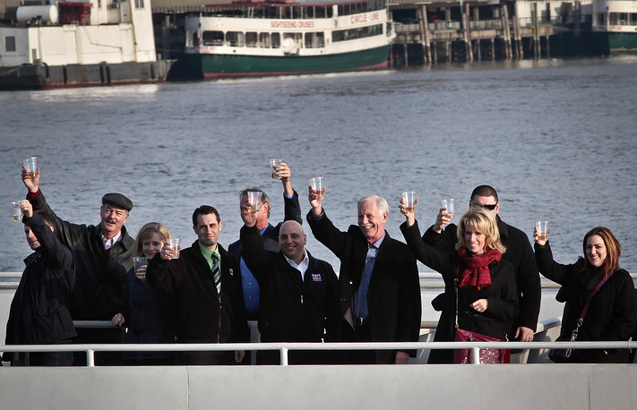 """Captain Chesley """"Sully"""" Sullenberger, pilot who safely glided US Airways Flight 1549 to a water landing 5 years ago, with survivors and rescuers marking the anniversary of the event, January 15, 2014"""