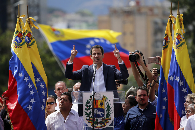 Juan Guaido, head of Venezuela's opposition-run congress, declares himself interim president of the nation until elections can be held during a rally demanding President Nicolas Maduro's resignation in Caracas