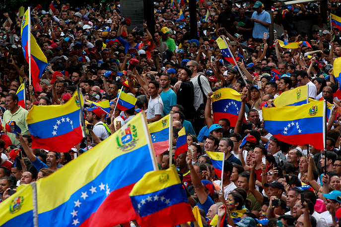People demonstrate against the Government of President Nicolas Maduro in Caracas