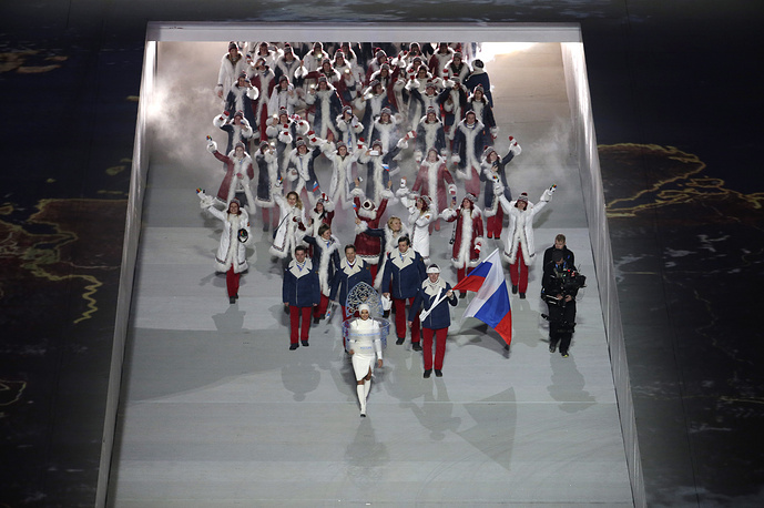 Team Russia with flag bearer Alexander Zubkov marching during the ceremony