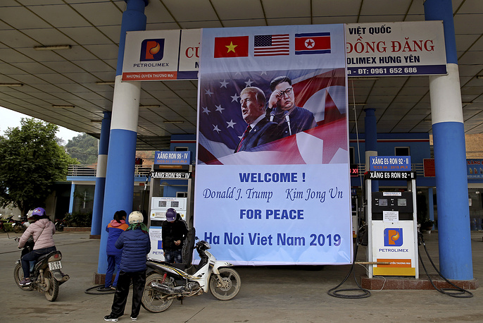 A poster featuring the upcoming second US-North Korean summit is seen at a gas station in Dong Dang, Vietnam