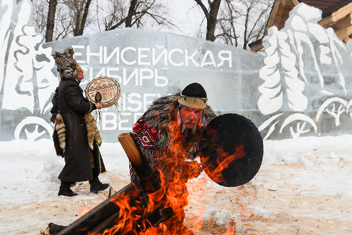 Residents in traditional costumes dance around the fire in an ethnic village built to represent traditions and lifestyle of the indigenous minorities of the Krasnoyarsk Territory population and located on Tatyshev Island in the park of the 2019 Winter Universiade scheduled to start on March 2 in Krasnoyarsk, February 28
