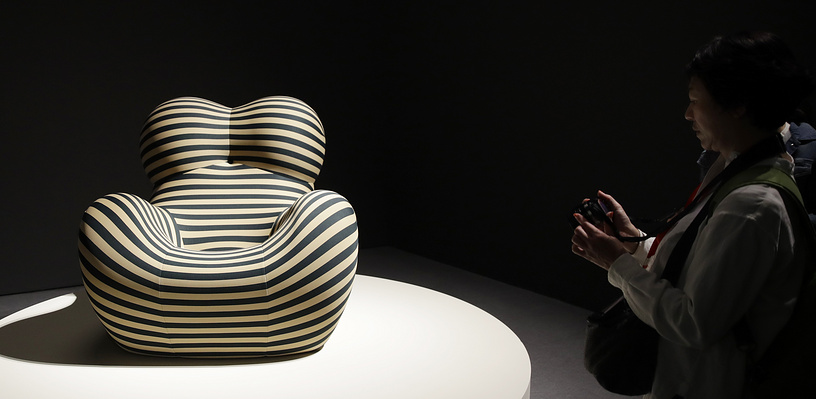 A visitor looks at a creation by Italian designer Gaetano Pesce