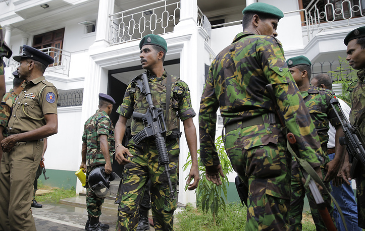 Sri Lankan security forces officers securing a site believed to be a hide out of the militants following a shoot out in Colombo