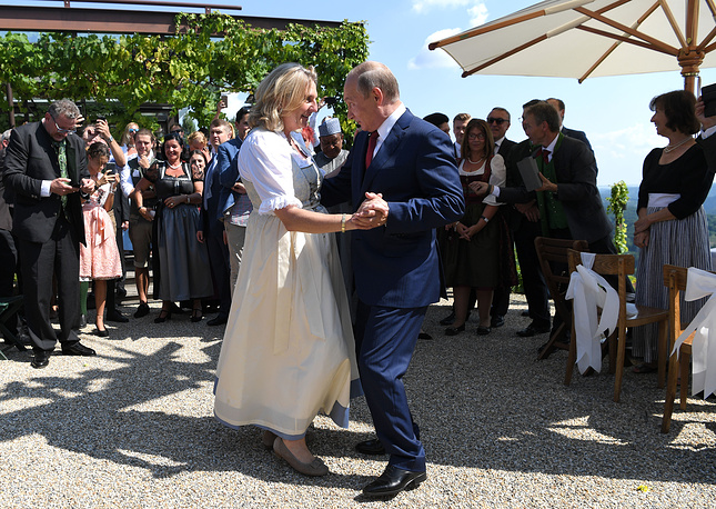 Russian President Vladimir Putin dancing with Austrian Foreign Minister Karin Kneissl during her wedding to Austrian businessman Wolfgang Meilinger in Gamlitz, Austria, 2018