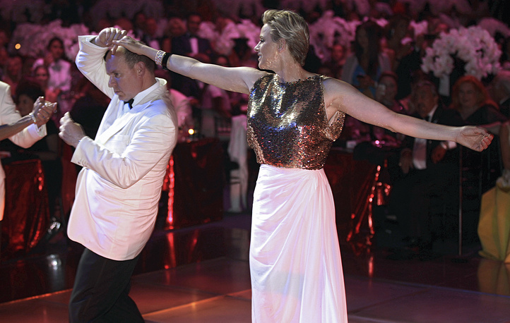 "Prince Albert II of Monaco and his wife Princess Charlene dancing during the ""Red Cross Gala"" in Monaco, 2012"