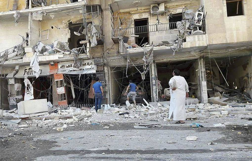Buildings aftermath of airstrikes in eastern Aleppo, Syria Syrian Civil Defense White Helmets via AP